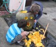 Carving their home-grown pumpkin!