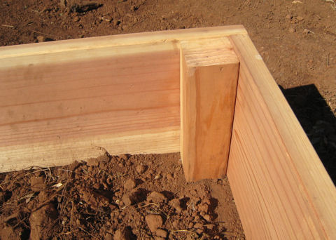 Stiffen box by fastening 4x4 or 2x2 pieces of wood at corners.